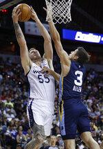Memphis Grizzlies' Grayson Allen, right, fouls Minnesota Timberwolves' Mitchell Creek during the first half of an NBA summer league basketball game Monday, July 15, 2019, in Las Vegas. (AP Photo/John Locher)