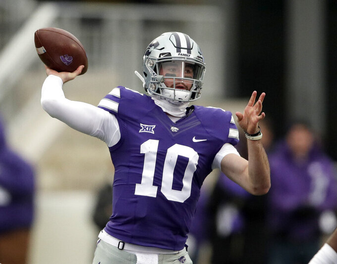 FILE - In this Nov. 17, 2018, file photo, Kansas State quarterback Skylar Thompson (10) passes to a teammate during the first half of an NCAA college football game against Texas Tech, in Manhattan, Kan. There is no question whether Thompson will be under center when the Wildcats open the season against Nicholls State. Nor is there any doubt he'll be there the rest of the year. (AP Photo/Orlin Wagner, FIle)