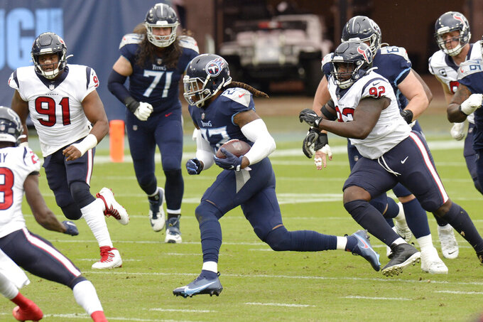 Tennessee Titans running back Derrick Henry (22) carries the ball against the Houston Texans in the first half of an NFL football game Sunday, Oct. 18, 2020, in Nashville, Tenn. (AP Photo/Mark Zaleski)