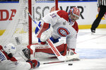 Montreal Canadiens goaltender Carey Price (31) plays the puck during the first period in Game 5 of the NHL hockey Stanley Cup finals against the Tampa Bay Lightning, Wednesday, July 7, 2021, in Tampa, Fla. (AP Photo/Phelan Ebenhack)