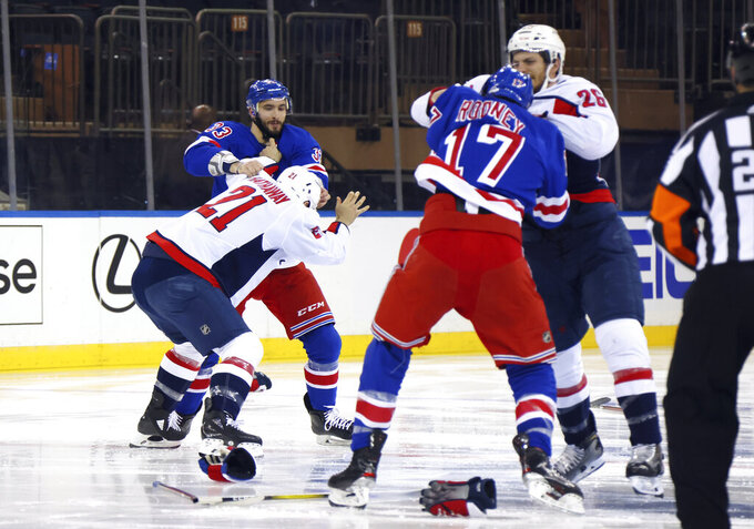 Washington Capitals and New York Rangers fight in the opening seconds of an NHL hockey game Wednesday, May 5, 2021, in New York. (Bruce Bennett/Pool Photo via AP)