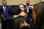 Rep. Alexandria Ocasio-Cortez, D-N.Y., hugs Yazmin Juárez, whose daughter Mariee, 1, died after being released from detention by U.S. Immigration and Customs Enforcement (ICE), after Juárez testified to a House Oversight subcommittee hearing on Civil Rights and Civil Liberties about the treatment of immigrant children at the southern border, Wednesday, July 10, 2019, on Capitol Hill in Washington. (AP Photo/Jacquelyn Martin)