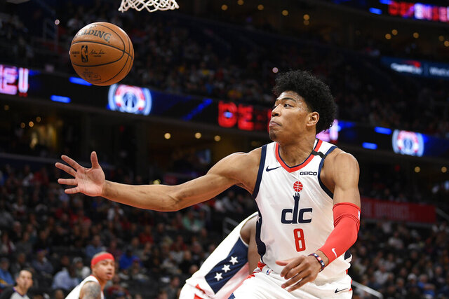 Washington Wizards forward Rui Hachimura (8), of Japan, goes for the ball during the first half of an NBA basketball game against the Golden State Warriors, Monday, Feb. 3, 2020, in Washington. (AP Photo/Nick Wass)
