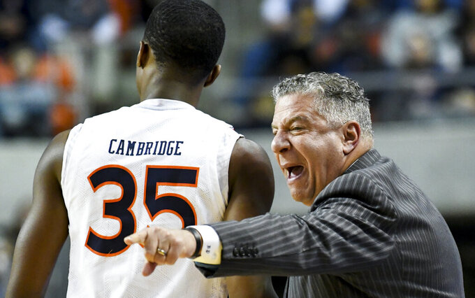 Auburn head coach Bruce Pearl, right, talks with guard Devan Cambridge (35) during the first half of an NCAA college basketball game against North Carolina State, Thursday, Dec. 19, 2019, in Auburn, Ala. (AP Photo/Julie Bennett)