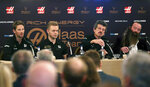 The launch of the new car for Rich Energy Haas F1 Team 2019, with from left, Romain Grosjean, Kevin Magnussen, Team Principal Guenther Steiner and Rich Energy CEO William Storey, at the Royal Automobile Club in London, Thursday Feb. 7, 2019. (Steven Paston/PA via AP)