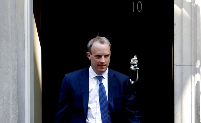 """FILE - In this Wednesday April 22, 2020 file photo, Britain's Foreign Secretary Dominic Raab leaves 10 Downing Street, London. Britain's foreign secretary hinted Sunday, July 19 he may move to suspend the U.K.'s extradition arrangements with Hong Kong, and accused Beijing of """"gross and egregious"""" human rights abuses against its Uighur population in China's western province of Xinjiang. (AP Photo/Frank Augstein, file)"""