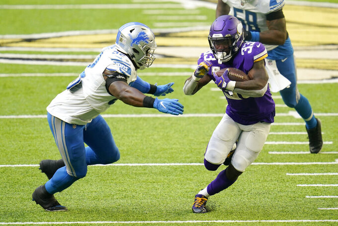 Minnesota Vikings running back Dalvin Cook (33) runs from Detroit Lions linebacker Christian Jones, left, during the second half of an NFL football game, Sunday, Nov. 8, 2020, in Minneapolis. (AP Photo/Jim Mone)