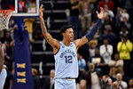 In this Oct. 27, 2019, photo, Memphis Grizzlies guard Ja Morant (12) gestures to the crowd in the second half of an NBA basketball game against the Brooklyn Nets, in Memphis, Tenn. Morant provided an inspiration to all small-conference players when he earned All-America honors at Murray last season and went to the Memphis Grizzlies with the second overall pick in the NBA Draft. (AP Photo/Brandon Dill)