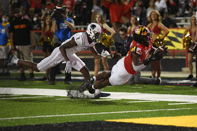 Maryland running back Tayon Fleet-Davis (8) dives for a touchdown past Howard defensive back Jalen Smith (2) during the first half of an NCAA college football game, Saturday, Sept. 11, 2021, in College Park, Md. (AP Photo/Nick Wass)