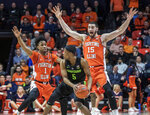 Illinois guard Trent Frazier (1) and forward Giorgi Bezhanishvili (15) pressure Michigan State guard Cassius Winston (5) during the first half of an NCAA college basketball game in Champaign, Ill., Tuesday, Feb. 5, 2019. (AP Photo/Rick Danzl)