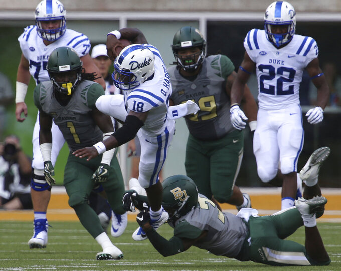 Duke quarterback Quentin Harris (18) leaps over Baylor safety Chris Miller (3) in the first half of an NCAA college football game, Saturday, Sept. 15, 2018, in Waco, Texas. (Rod Aydelotte/Waco Tribune-Herald via AP)