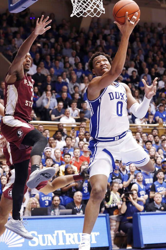 Duke forward Wendell Moore Jr. (0) drives to the basket while Florida State guard Trent Forrest (3) defends during the second half of an NCAA college basketball game in Durham, N.C., Monday, Feb. 10, 2020. (AP Photo/Gerry Broome)