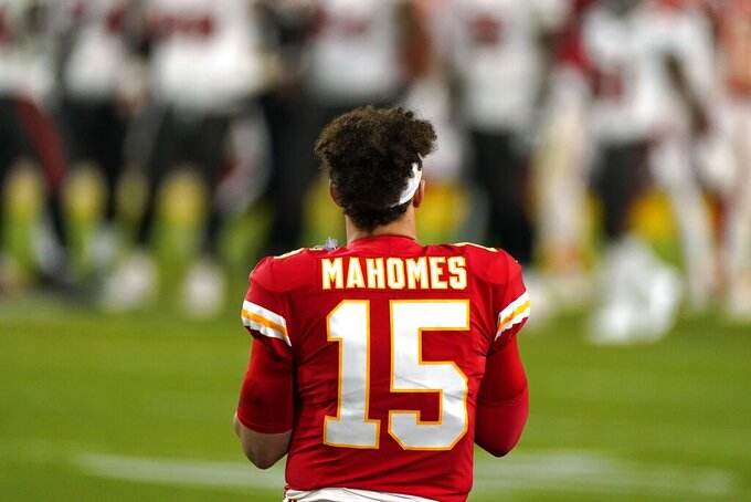 Kansas City Chiefs quarterback Patrick Mahomes watches from the sideline during the second half of the NFL Super Bowl 55 football game against the Tampa Bay Buccaneers, Sunday, Feb. 7, 2021, in Tampa, Fla. (AP Photo/Gregory Bull)