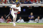 American League's Jorge Polanco, of the Minnesota Twins, watches his RBI single during the fifth inning of the MLB baseball All-Star Game against the National League, Tuesday, July 9, 2019, in Cleveland. (AP Photo/Tony Dejak)