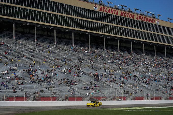 Martin Truex Jr., drives during a NASCAR Xfinity Series at Atlanta Motor Speedway on Saturday, March 20, 2021, in Hampton, Ga. (AP Photo/Brynn Anderson)