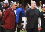Atlanta Falcons owner Arthur Blank and head coach Dan Quinn watch the team prepare to play the Seattle Seahawks in an NFL football game on Sunday, Oct. 27, 2019, in Atlanta. (Curtis Compton/Atlanta Journal-Constitution via AP)