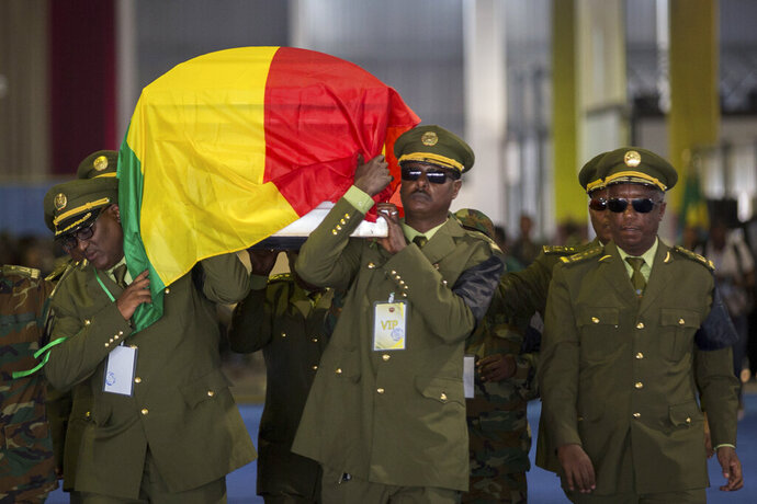 The coffin of assassinated army chief Gen. Seare Mekonnen is taken away for burial after a state ceremony at the Millennium Hall in the capital Addis Ababa, Ethiopia Tuesday, June 25, 2019. Ethiopia's Prime Minister Abiy Ahmed sobbed openly at the service Tuesday for the military chief who was assassinated by his own bodyguard over the weekend. (AP Photo/Mulugeta Ayene)