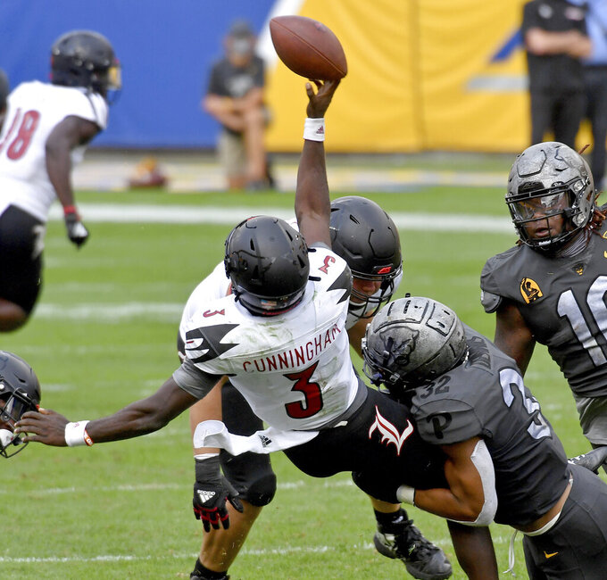 FILE  - In this Saturday, Sept. 26, 2020, file photo, Pittsburgh linebacker SirVocea Dennis takes down Louisville quarterback Malik Cunningham as he gets a pass off in the fourth quarter during an NCAA college football game at Heinz Field, in Pittsburgh. Louisville quarterback Malik Cunningham and Georgia Tech's Jeff Sims will be looking to cut down on interceptions and other problems that have left each team with two straight losses entering Friday night's, Oct. 9  game in Atlanta.(Matt Freed/Pittsburgh Post-Gazette via AP, File)