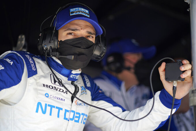 Alex Palou, of Spain, watches during practice for the Indianapolis 500 auto race at Indianapolis Motor Speedway, Friday, May 21, 2021, in Indianapolis. (AP Photo/Darron Cummings)
