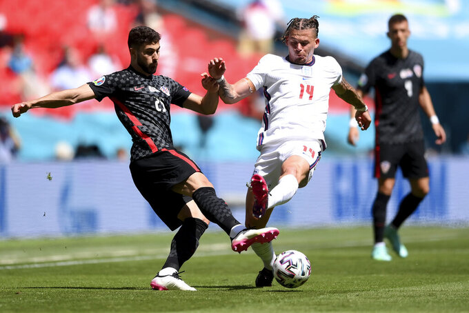 England's Kalvin Phillips and Croatia's Joško Gvardiol go for the ball during the Euro 2020 soccer championship group D match between England and Croatia, at Wembley stadium, London, Sunday, June 13, 2021. (Laurence Griffiths, Pool via AP)