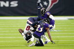 Houston Texans tight end Jordan Akins (88) is upended by Baltimore Ravens cornerback Anthony Averett (23) after making a catch during the second half of an NFL football game Sunday, Sept. 20, 2020, in Houston. (AP Photo/David J. Phillip)