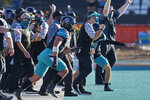 Coastal Carolina head coach Jamey Chadwell, center with visor, pumps his fist after defeating Appalachian State 34-23 during an NCAA college football game Saturday, Nov. 21, 2020, in Conway, S.C. (AP Photo/Richard Shiro)