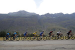The pack with France's Julian Alaphilippe wearing the overall leader's yellow jersey rides during the nineteenth stage of the Tour de France cycling race over 126,5 kilometers (78,60 miles) with start in Saint Jean De Maurienne and finish in Tignes, France, Friday, July 26, 2019. (AP Photo/Thibault Camus)