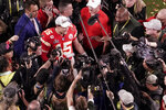 FILE - In this Feb. 2, 2020, file photo, Kansas City Chiefs quarterback Patrick Mahomes (15) is surrounded by media after his team won the NFL Super Bowl 54 football game against the San Francisco 49ers, in Miami Gardens, Fla. As sports prepare to resume, journalists are facing the same reckoning that their colleagues who cover politics, education and entertainment have encountered — coming up with new approaches to coverage with reduced access and resources. Professional leagues closed media access to locker rooms and clubhouses in early March. (AP Photo/Morry Gash, File)