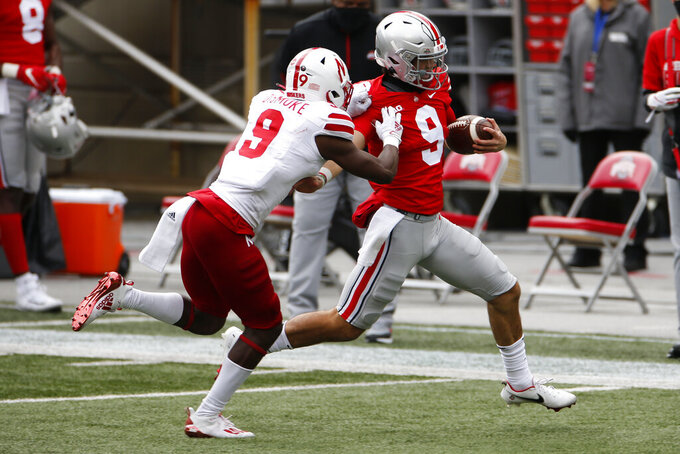 Nebraska defensive back Marquel Dismuke, left, forces Ohio State quarterback Jack Miller out of bounds during the second half of an NCAA college football game Saturday, Oct. 24, 2020, in Columbus, Ohio. Ohio State beat Nebraska 52-17. (AP Photo/Jay LaPrete)