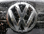 FILE - In this Friday, Nov. 18, 2016 file photo the Volkswagen logo is photographed through rain drops on a window in Frankfurt, Germany.  Germany's Federal Court has ruled Volkswagen must buy back cars from owners who bought vehicles rigged to cheat in emissions tests but consumers must accept current value taking into account the mileage they drove rather than the full purchase price. (AP Photo/Michael Probst, file)