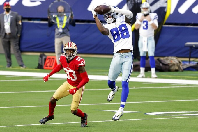 Dallas Cowboys wide receiver CeeDee Lamb (88) catches a pass in front of San Francisco 49ers safety Tarvarius Moore (33) in the first half of an NFL football game in Arlington, Texas, Sunday, Dec. 20, 2020. (AP Photo/Michael Ainsworth)