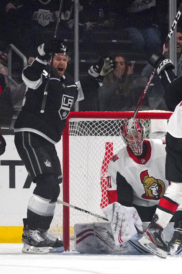Los Angeles Kings center Trevor Lewis, left, celebrates his goal as Ottawa Senators goaltender Craig Anderson kneels at right during the first period of an NHL hockey game Wednesday, March 11, 2020, in Los Angeles. (AP Photo/Mark J. Terrill)
