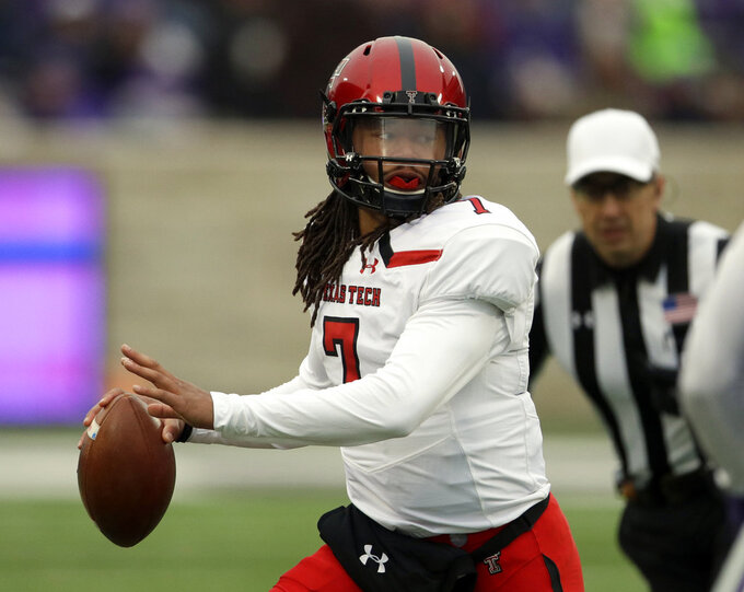 Texas Tech quarterback Jett Duffey (7) looks for a receiver during the first half of an NCAA college football game against Kansas State in Manhattan, Kan., Saturday, Nov. 17, 2018. (AP Photo/Orlin Wagner)