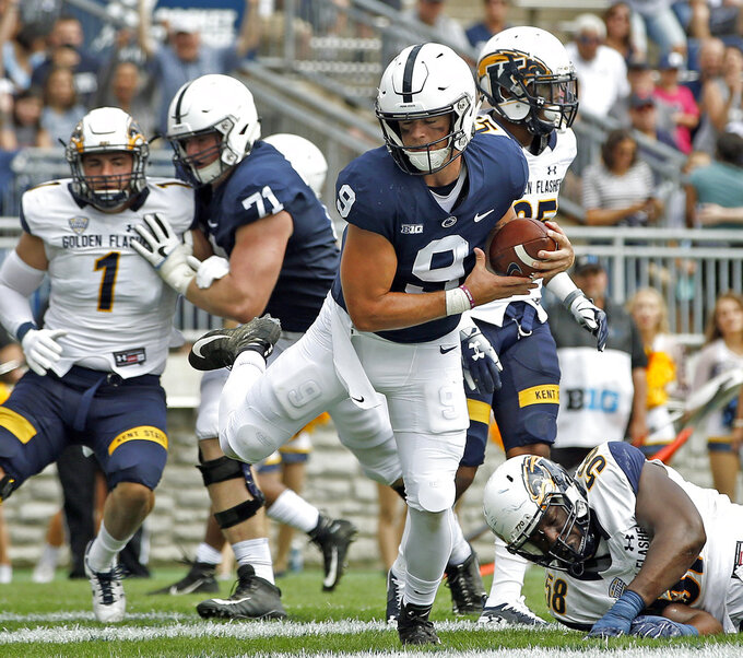 Penn State quarterback Trace McSorley (9) runs in for a touchdown against Kent State during the first half of an NCAA college football game in State College, Pa., Saturday, Sept. 15, 2018. (AP Photo/Chris Knight)