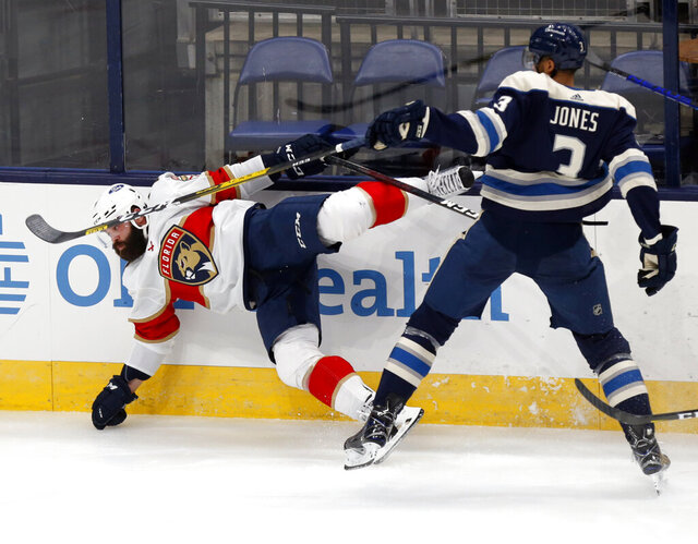 Florida Panthers defenseman Radko Gudas, left, of the Czech Republic, collides with Columbus Blue Jackets defenseman Seth Jones during the second period of an NHL hockey game in Columbus, Ohio, Tuesday, Jan. 26, 2021. (AP Photo/Paul Vernon)