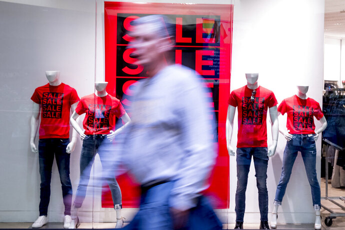 FILE - In this Jan. 22, 2020, file photo a person walks by a retail clothing store in Valley West Mall in West Des Moines, Iowa. On Friday, Feb. 14, the Commerce Department releases U.S. retail sales data for January. (AP Photo/Andrew Harnik, File)