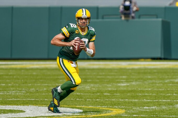 Green Bay Packers' Aaron Rodgers scrambles during the first half of an NFL football game against the Detroit Lions Sunday, Sept. 20, 2020, in Green Bay, Wis. (AP Photo/Morry Gash)