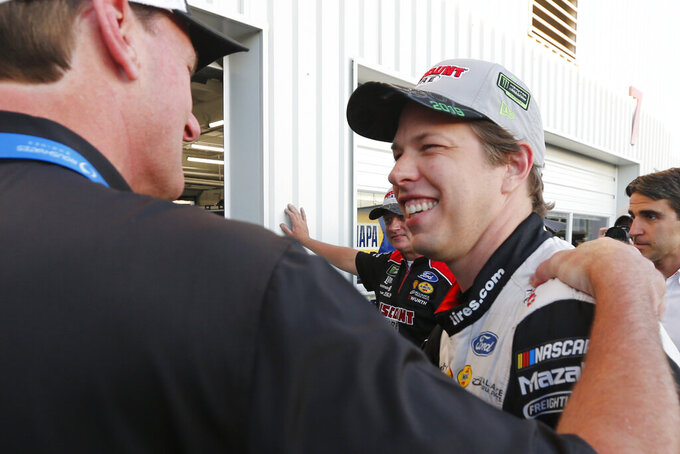 Brad Keselowski, front right, smiles after winning the pole for a NASCAR Monster Energy Cup auto race at Richmond Raceway in Richmond, Va., Friday, Sept. 20, 2019. (AP Photo/Steve Helber)