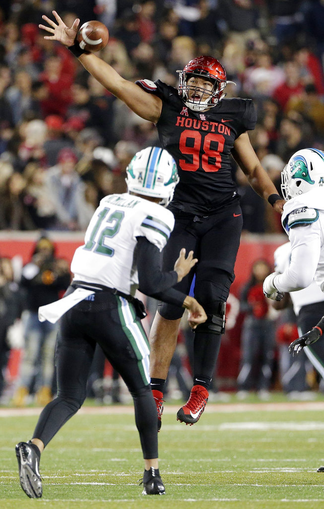 Houston defensive lineman Payton Turner (98) deflects a pass by Tulane quarterback Justin McMillan (12) that was intercepted by Houston linebacker Roman Brown during the first half of an NCAA college football game Thursday, Nov. 15, 2018, in Houston. (Michael Wyke/Houston Chronicle via AP)