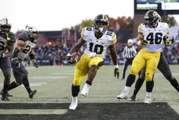 Iowa running back Mekhi Sargent (10) scores a touchdown against Purdue in the second half of an NCAA college football game in West Lafayette, Ind., Saturday, Nov. 3, 2018. (AP Photo/AJ Mast)
