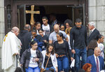 Friends and family of Leonel Rondon, 18, who died in the gas explosions in South Lawrence last week, leave after his funeral at St. Mary the Assumption Parish in Lawrence, Mass., Wednesday, Sept. 19, 2018. (Amanda Sabga/The Eagle-Tribune via AP)