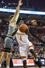 Texas' Andrew Jones (1) goes to shoot against West Virginia during an NCAA college basketball game in Austin, Texas, Monday, Feb. 24, 2020. (Lola Gomez/Austin American-Statesman via AP)