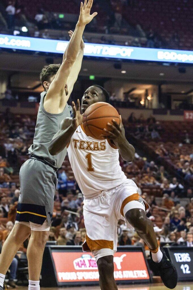 Texas' Andrew Jones (1) goes to shoot against West Virginia during an NCAA college basketball game in Austin, Texas, Monday, Feb. 24, 2020. (Lola Gomez/Austin American-Statesman via AP)