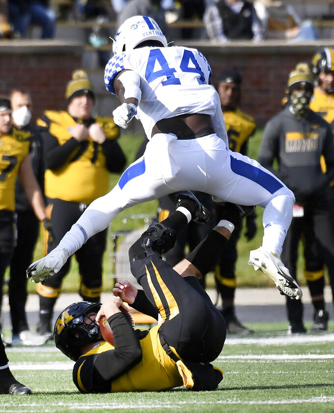 Kentucky linebacker Jamin Davis (44) leaps over Missouri quarterback Connor Bazelak, bottom, during the first half an NCAA college football game Saturday, Oct. 24, 2020, in Columbia, Mo. (AP Photo/L.G. Patterson)