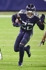 Tennessee Titans running back Derrick Henry (22) carries the ball in an NFL game against the Indianapolis Colts, Thursday, Nov. 12, 2020 in Nashville, Tenn. The Colts defeated the Titans 34-17. (Margaret Bowles via AP)
