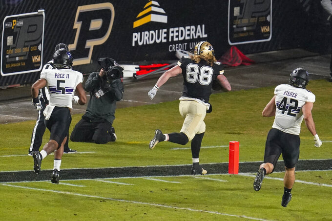 Purdue tight end Garrett Miller (88) runs in for a touchdown against Northwestern during the first half of an NCAA college football game in West Lafayette, Ind., Saturday, Nov. 14, 2020. (AP Photo/Michael Conroy)