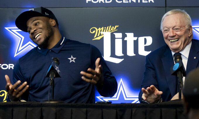 Dallas Cowboys first-round draft pick linebacker Micah Parsons, left, and Dallas Cowboys owner Jerry Jones speak to the media at the Dallas Cowboys headquarters, Friday, April 30, 2021, in Frisco, Texas. (AP Photo/Brandon Wade)