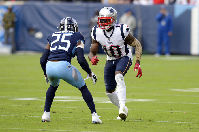 FILE - In this Nov. 11, 2018, file photo, New England Patriots wide receiver Josh Gordon (10) is defended by Tennessee Titans cornerback Adoree' Jackson (25) in the first half of an NFL football game in Nashville, Tenn. The NFL has conditionally reinstated Gordon. Commissioner Roger Goodell notified Gordon on Friday, Aug. 16, 2019, that on Sunday, Gordon can rejoin the team for meetings and conditioning and individual workouts. (AP Photo/Mark Zaleski, File)