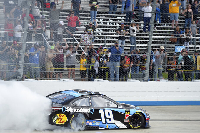 Driver Martin Truex Jr. (19) performs a burnout after winning a NASCAR Cup Series auto race, Monday, May 6, 2019, at Dover International Speedway in Dover, Del. (AP Photo/Will Newton)