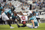 Atlanta Falcons wide receiver Olamide Zaccheaus (17) is brought down by Jacksonville Jaguars cornerback Tae Hayes (30) and defensive back Andrew Wingard, right, during the first half of an NFL preseason football game Thursday, Aug. 29, 2019, in Jacksonville, Fla. (AP Photo/Phelan M. Ebenhack)